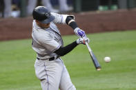 Colorado Rockies' Trevor Story singles to load the bases against the Seattle Mariners in the fifth inning of a baseball game Saturday, Aug. 8, 2020, in Seattle. (AP Photo/Elaine Thompson)