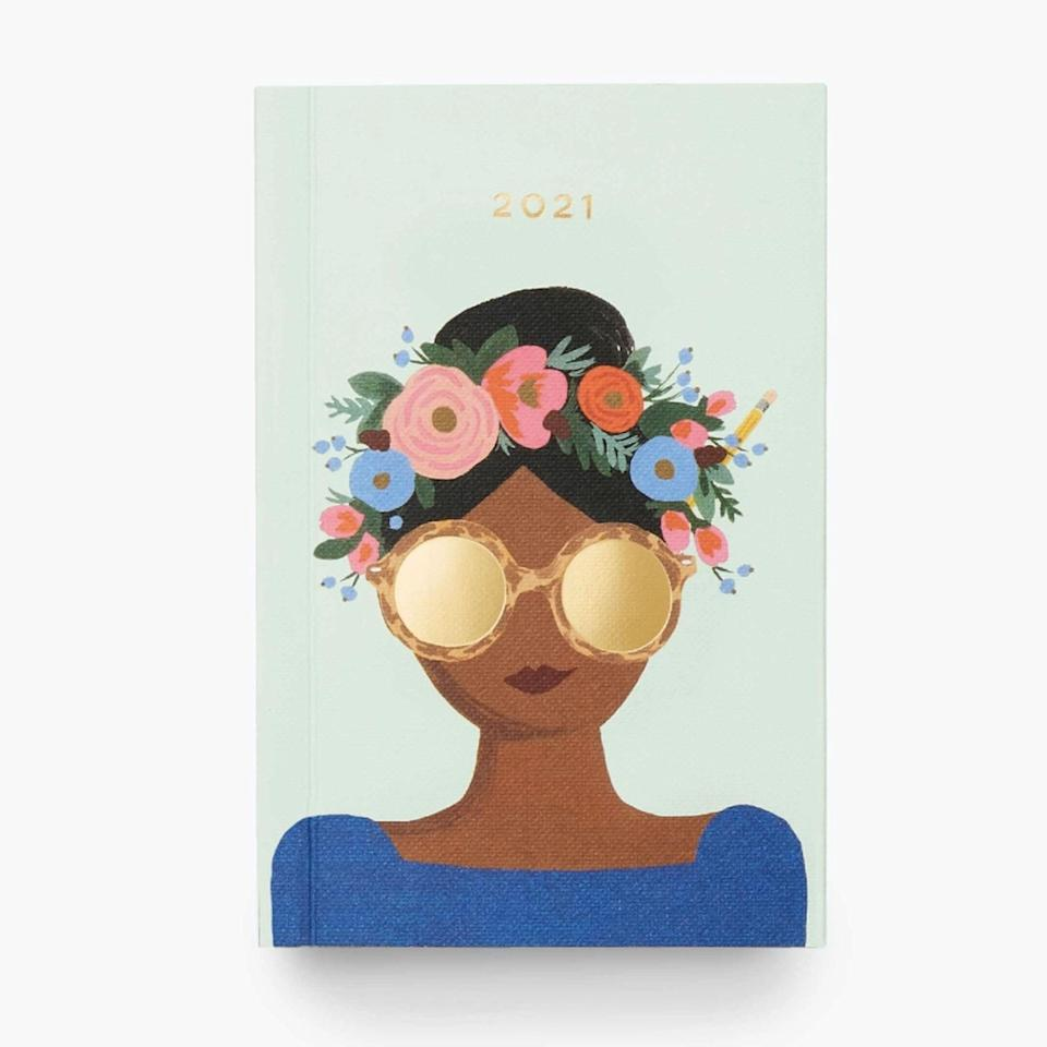 "This petite pocket planner featuring a whimsical lady is the perfect pick for anyone manifesting a Coachella 2021 comeback nightly. $14, Rifle Paper Co.. <a href=""https://riflepaperco.com/2021-flower-crown-12-month-pocket-planner"" rel=""nofollow noopener"" target=""_blank"" data-ylk=""slk:Get it now!"" class=""link rapid-noclick-resp"">Get it now!</a>"