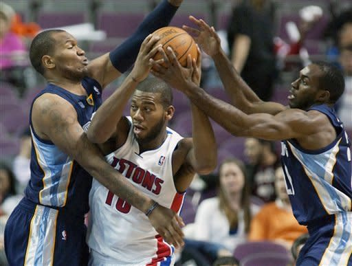 Memphis Grizzlies' Marreese Speights, left, and Quincy Pondexter, right, box in Detroit Pistons' Greg Monroe (10) in the first half of an NBA basketball game on Friday, Jan. 20, 2012, in Auburn Hills, Mich. (AP Photo/Duane Burleson)