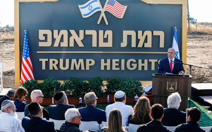 """... and giving a speech at the new Israeli settlement of """"Ramat Trump"""", or """"Trump Heights"""" in annexed Golan Heights - JALAA MAREY/AFP"""