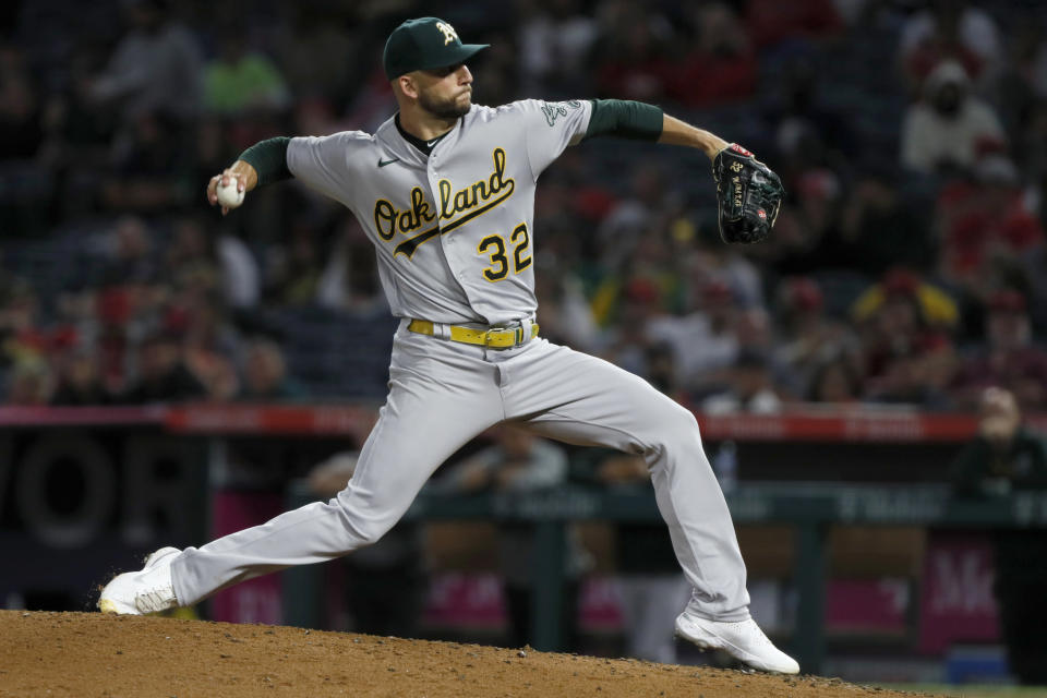 Oakland Athletics starting pitcher James Kaprielian winds up during the fifth inning of the team's baseball game against Los Angeles Angels in Anaheim, Calif., Saturday, Sept. 18, 2021. (AP Photo/Alex Gallardo)