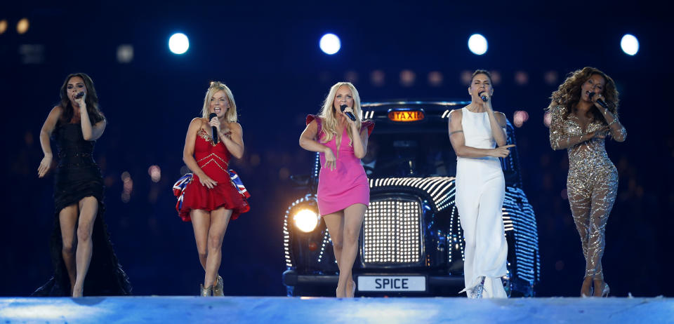 """FILE - In this Sunday, Aug. 12, 2012 file photo, British band 'The Spice Girls' perform during the Closing Ceremony at the 2012 Summer Olympics, in London. All five former members of the Spice Girls have met up amid rumors of a plan to reunite the girl-power group.Photos posted by several group members on social media showed Victoria """"Posh Spice"""" Beckham, Melanie """"Sporty Spice"""" Chisholm, Emma """"Baby Spice"""" Bunton, Melanie """"Scary Spice"""" Brown and Geri """"Ginger Spice"""" Horner. They had been seen earlier Friday, Feb. 2, 2018 arriving at Horner's home north of London, along with former manager Simon Fuller. (AP Photo/Matt Dunham, file)"""