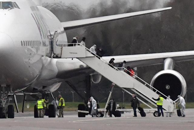 Passengers disembarking an aircraft repatriating British and other nationalities to the UK from the coronavirus-hit city of Wuhan in China, arrives at RAF Brize Norton in Oxfordshire.