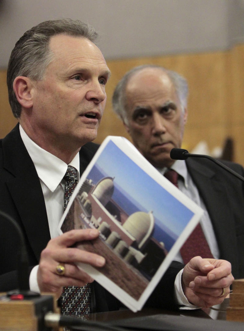 Steve David, director of site services at the Diablo Canyon Power Plant, displays a picture of the nuclear power plant, located near San Luis Obisop, as he discusses the plant's safety in case of an earthquake, during a hearing at the Sacramento,  Calif., Monday March 21, 2011.  A Senate select committee took testimony from various state agencies, natural gas utilities and the operators of California's nuclear power plants on the state's ability to handle an earthquake and possible tsunami like the one the struck Japan last week.   At right is Daniel Hirsch, lecturer in nuclear policy at the University of California, Santa Cruz. (AP Photo/Rich Pedroncelli)