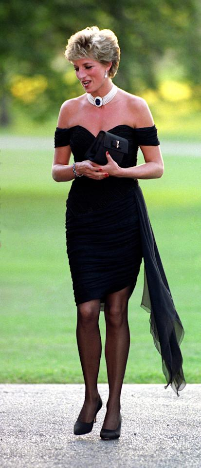 <p>This was the LBD worth a thousand words; the figure-hugging, ruched mini dress from Greek designer Christina Stambolian that Diana wore to a party at the Serpentine Gallery in 1994 while a documentary about the breakdown of her marriage to Prince Charles was airing. <i>[Photo: PA Images]</i></p>