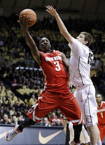Ohio State guard Shannon Scott (3) shoots under Purdue forward Donnie Hale in the first half of an NCAA college basketball game in West Lafayette, Ind., Tuesday, Jan. 8, 2013. (AP Photo/Michael Conroy)