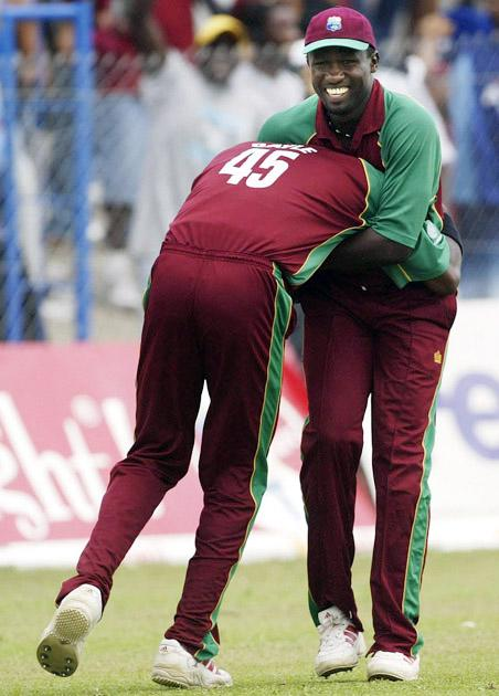 PORT OF SPAIN, TRINIDAD - MAY 25:  Wavell Hinds and Chris Gayle of the West Indies celebrate the wicket of Ricky Ponting of Australia during the 5th One Day International between the West Indies and Australia played May 25, 2003 at Queens Park Oval Port of Spain, Trinidad.  (Photo by Hamish Blair/Getty Images)