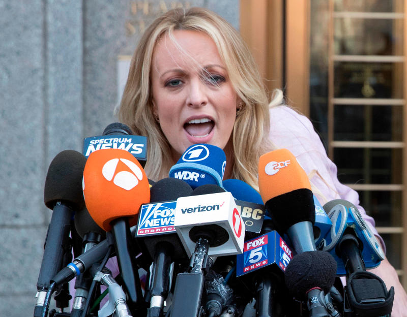 Stormy Daniels speaks to reporters outside the federal court in New York after she filed a defamation complaint against the President. (AP Photo/Mary Altaffer)