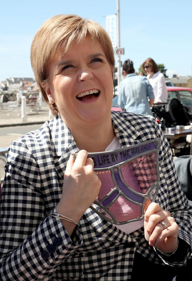 <p>Nicola Sturgeon was presented with a pair of stained-glass pants, which she designed for the Prostate Cancer UK charity, on a General Election campaign visit to Anstruther, Fife. (PA Images) </p>