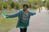 """Joi McCondichie, whose grandmother was Tulsa Race Massacre survivor Eldoris McCondichie, stands on a recreational trail in Tulsa, Okla., on Saturday, April 10, 2021, which was once the railroad tracks that Black Tulsans walked along to escape the violence of the Tulsa Race Massacre a century earlier. On Tuesday morning, June 1, 2021, McCondichie's """"A Century Walk"""" will retrace Greenwood residents' escape. """"I thought this would be a beautiful way to commemorate the ancestors by having or attempting to walk a mile in their shoes,"""" she says. (AP Photo/Sue Ogrocki)"""