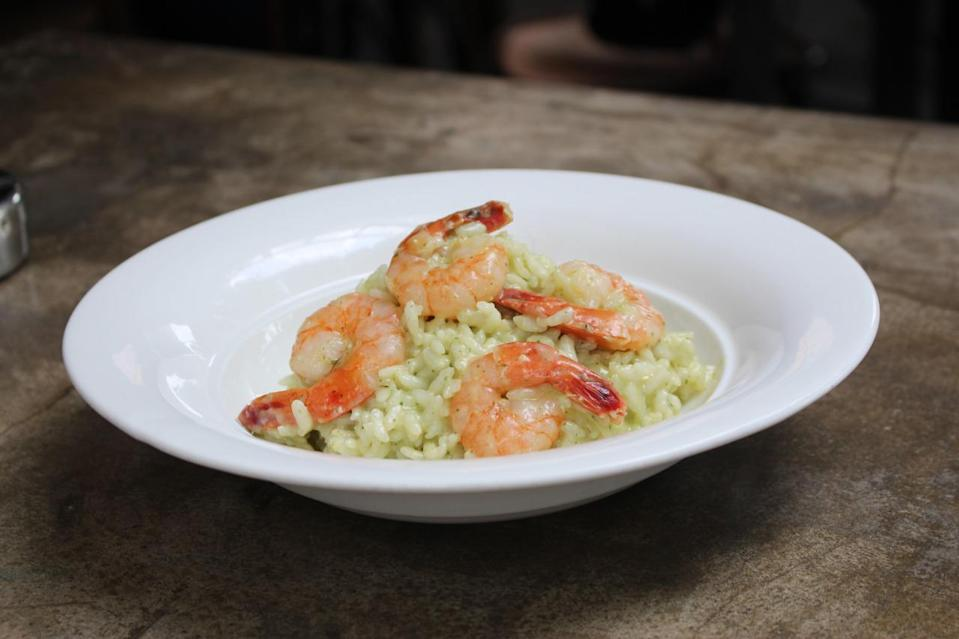 Another dish on the cheese wheel menu is the risotto ($26) with tiger prawns that is drizzled with basil pesto. (Photo: Yahoo Singapore)