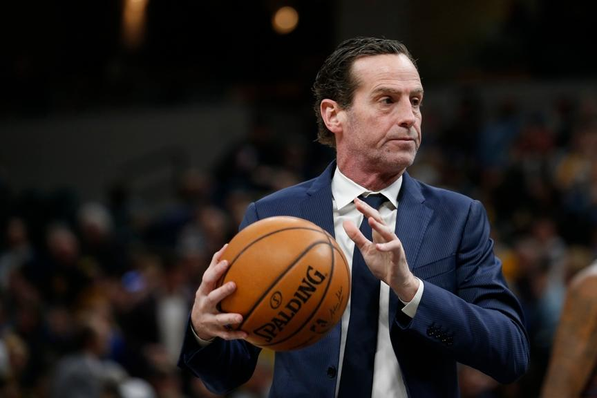 Kenny Atkinson holds Spalding ball