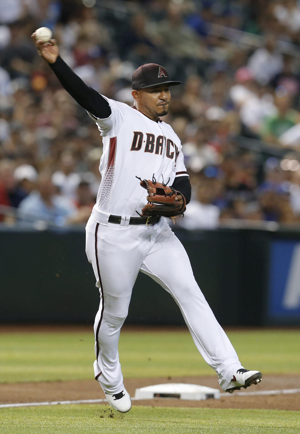 Arizona Diamondbacks third baseman Eduardo Escobar makes the off balance throw for an out on a ball hit by Los Angeles Dodgers' Will Smith in the fifth inning during a baseball game, Wednesday, June 5, 2019, in Phoenix. (AP Photo/Rick Scuteri)