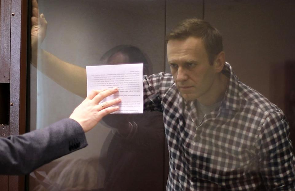 MOSCOW, RUSSIA - FEBRUARY 20, 2021: Russian opposition activist Alexei Navalny during an offsite hearing of the Moscow City Court into his appeal against the court ruling to convert his suspended sentence of three and a half years in the Yves Rocher case into a real jail term, at the Babushkinsky District Court. Video screen grab/Moscow City Court Press Office/TASS A STILL IMAGE TAKEN FROM VIDEO PROVIDED BY A THIRD PARTY. EDITORIAL USE ONLY  (Photo by Moscow City Court\TASS via Getty Images) (Photo: Moscow City Court via Getty Images)