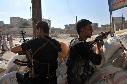 Syrian rebels man a checkpoint in the northern city of Aleppo