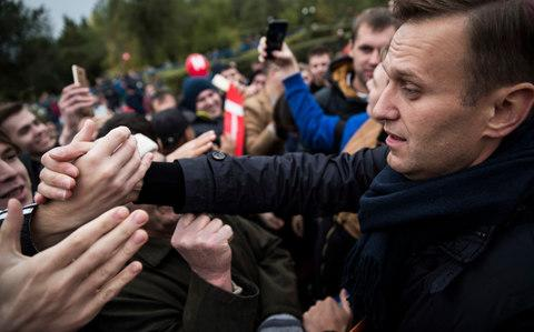Opposition leader Alexei Navalny greets supporters at a rally in Orenburg last month. - Credit: Evgeny Feldman/Navalny Campaign via AP