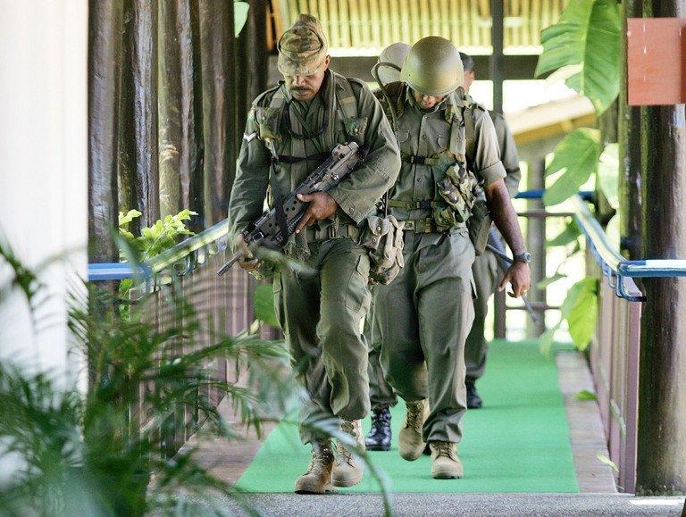 Fijian soldiers patrol near parliament in Suva, in 2006