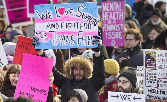 <p>People hold up signs during a women's march in Montreal, Saturday, Jan. 20, 2018. At least 38 municipalities across Canada, including Halifax, Montreal, Toronto and Vancouver, will host marches, rallies or other events throughout the day. (Photo: Graham Hughes/The Canadian Press via AP) </p>