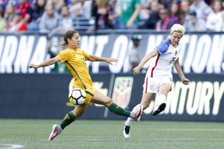 Jul 27, 2017; Seattle, WA, USA; USA midfielder Megan Rapinoe (15) passes against Australia midfielder Katrina Gorry (19) during the first half at Century Link Field. Mandatory Credit: Joe Nicholson-USA TODAY Sports