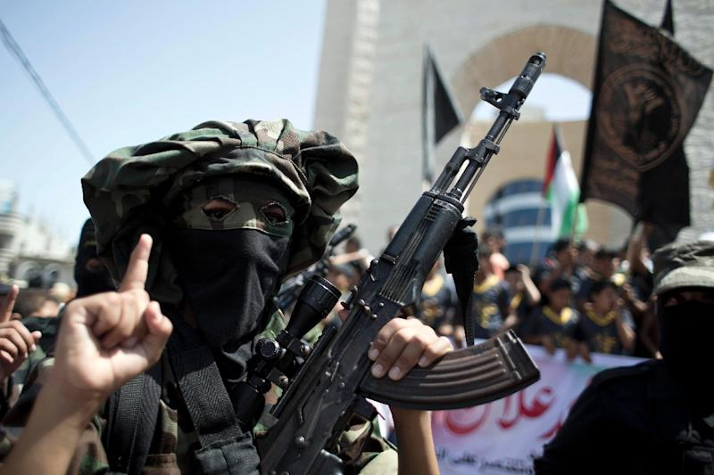 An Islamic Jihad fighter poses during a rally in support of Mohammed Allan (AFP Photo/Said Khatib)