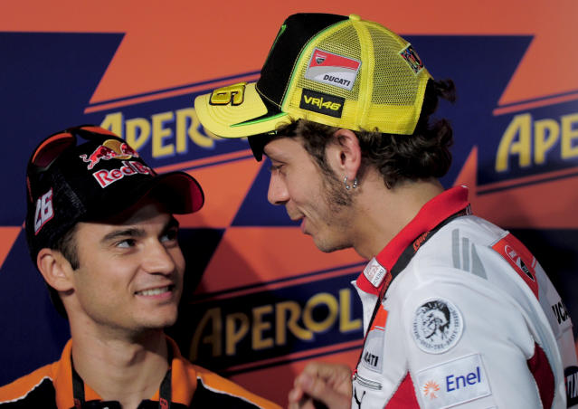 Repsol Honda Team Spanish Jorge Lorenzo (L) chats with Ducati Team's Italian rider Valentino Rossi during a press conference at the Catalunya racetrack in Montmelo, near Barcelona, on May 31, 2012, on eve of the Catalunya Moto GP Grand Prix training sessions. AFP PHOTO / JOSEP LAGOJOSEP LAGO/AFP/GettyImages