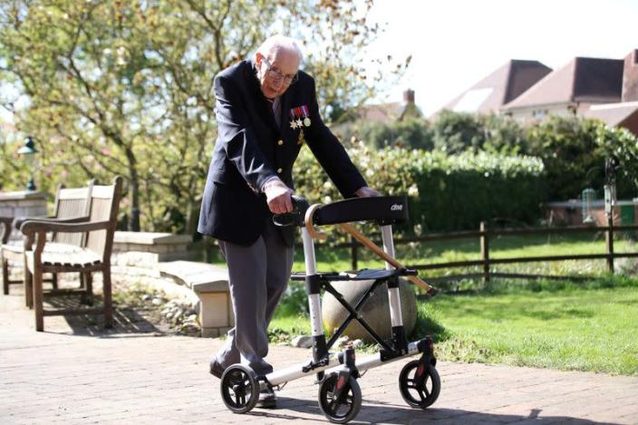 FILE PHOTO: Retired British Army Captain Moore walks to raise money for health workers