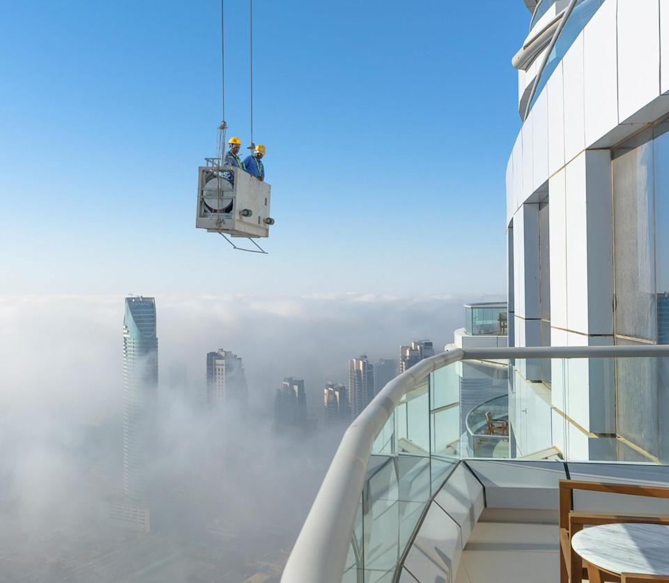 Window cleaners working on the 50th floor of the Address Downtown building in Dubai – 900 feet above the ground. (SWNS)