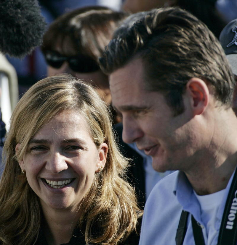 Spain's Infanta Cristina (L) and her husband Inaki Urdangarin smile during their visit at the Sanxenxo's yachting harbour, northern Spain, November 11, 2005. [The Volvo Ocean Race will leave from Vigo on the first ocean stage to Cape Town, South Africa on Saturday.]
