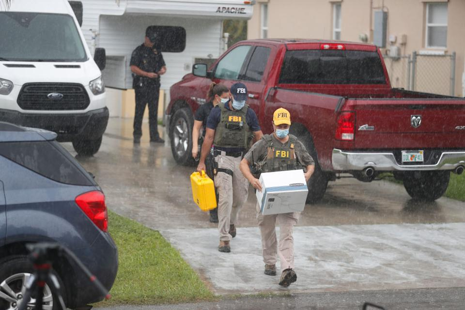 FBI agents begin to take away evidence from the family home of Brian Laundrie, who is a person of interest after his fiancee Gabby Petito went missing on in North Port, Florida.