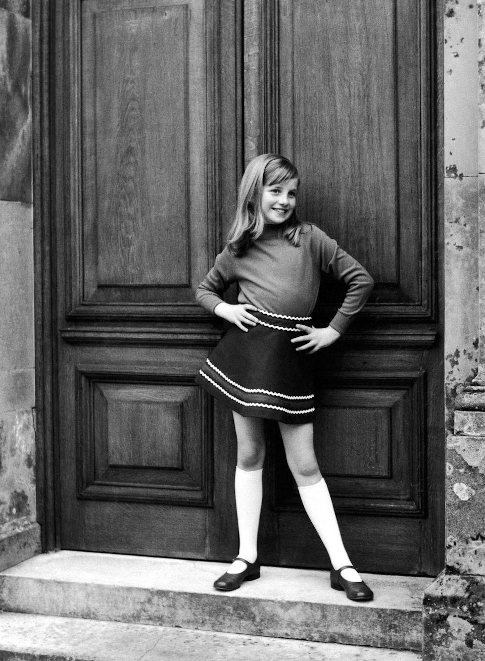 <p>A photo from a private family album shows Diana posing cheekily as a young girl. Obviously a natural in front of the camera, she also had a keen sense of style from an early age.</p>