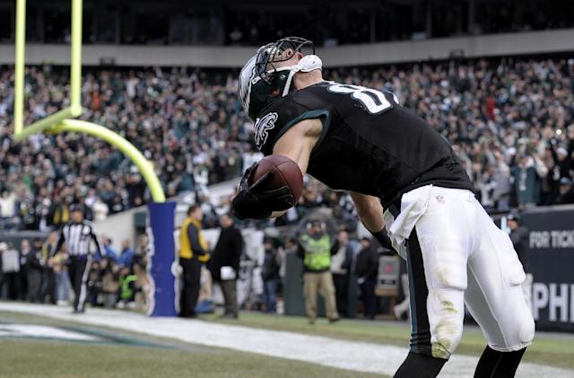 Philadelphia Eagles' Brent Celek celebrates after scoring a touchdown during the first half of an NFL football game against the Arizona Cardinals on Sunday, Dec. 1, 2013, in Philadelphia. (AP Photo/Michael Perez)