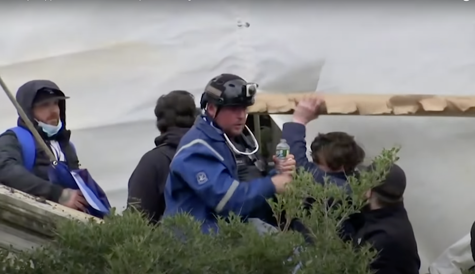 Court documents identified Guy Wesley Reffitt in this picture wearing a blue jacket and helmet with Go-Pro camera (YouTube/Reuters)