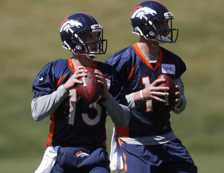 Trevor Siemian (13) and Paxton Lynch (12) will compete for the Broncos' starting quarterback job. (AP)