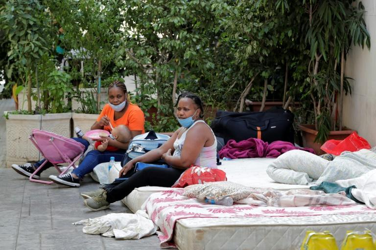 Kenyan women in Beirut camp outside their consulate asking to be repatriated home, some of the thousands of foreign workers wanting to leave Lebanon