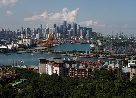 A view of Sentosa island and the skyline of the central business district in Singapore June 4, 2018. REUTERS/Edgar Su