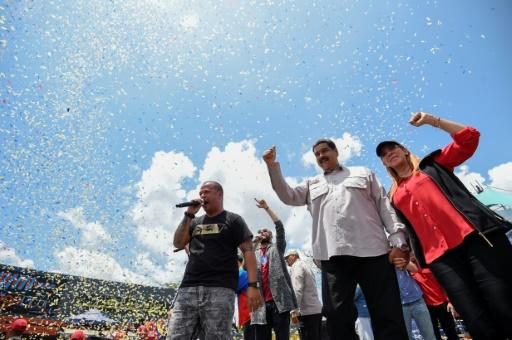 Venezuelan President and presidential candidate Nicolas Maduro (C) and his wife Cilia Flores (R) attend a rally ahead of Sunday's controversial elections