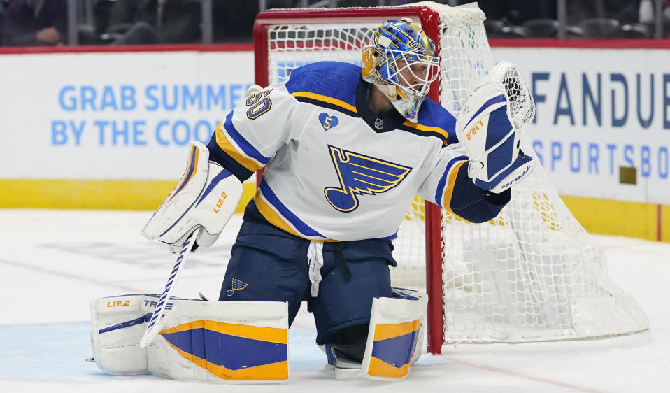 St. Louis Blues goaltender Jordan Binnington makes a glove save against the Colorado Avalanche in the second period of Game 1 of an NHL hockey Stanley Cup first-round playoff series Monday, May 17, 2021, in Denver. (AP Photo/David Zalubowski)