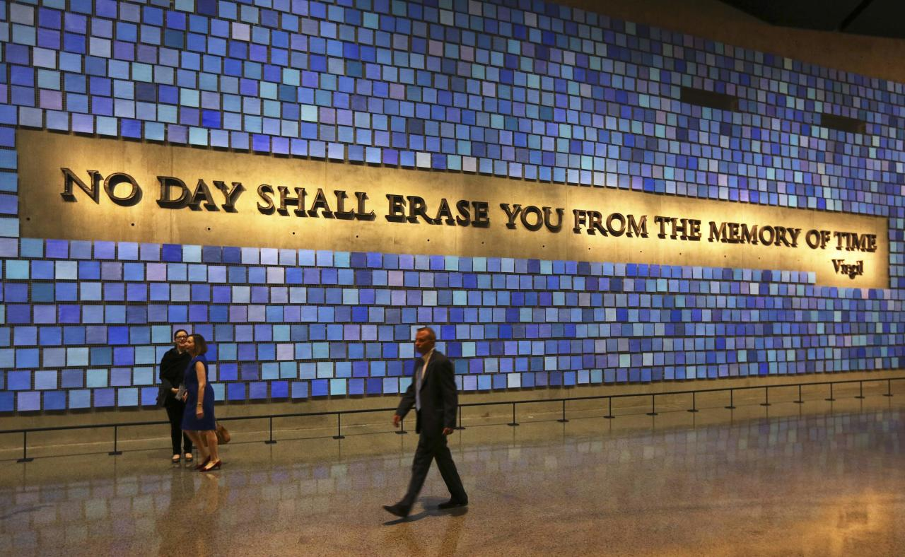 A quote from Virgil fills a wall of the museum prior to the dedication ceremony at the National September 11 Memorial Museum in New York, May 15, 2014. REUTERS/John Munson/Pool (UNITED STATES - Tags: POLITICS SOCIETY)
