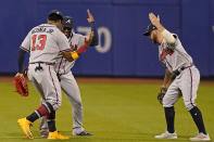 Atlanta Braves right fielder Ronald Acuña Jr. (13) celebrates with left fielder Guillermo Heredia, center, and center fielder Ender Inciarte after their victory over the New York Mets in the second baseball game of a doubleheader, Monday, June 21, 2021, in New York. (AP Photo/Kathy Willens)