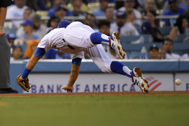 Los Angeles Dodgers third baseman Chris Taylor can't reach the ball on a two-run double by Tampa Bay Rays' Tommy Pham during the fifth inning of a baseball game Wednesday, Sept. 18, 2019, in Los Angeles. (AP Photo/Mark J. Terrill)
