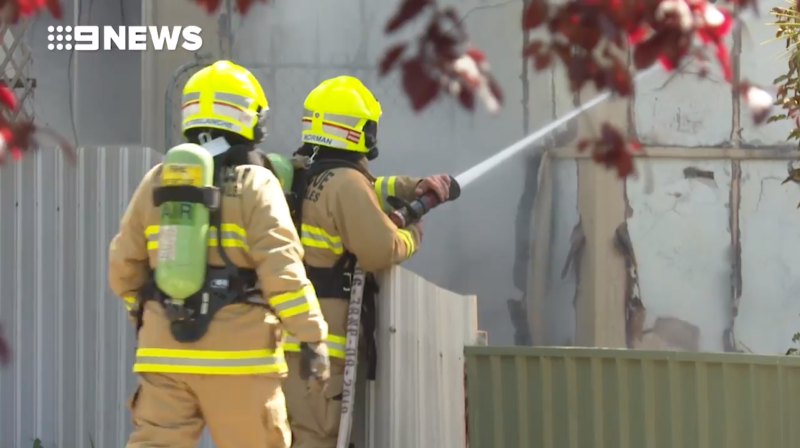 Two firefighters battle a house fire in North Albury.