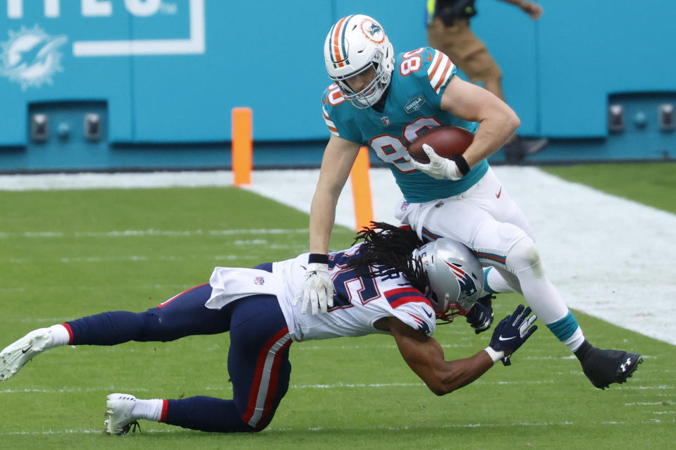 England Patriots defensive back Kyle Dugger (35) tackles Miami Dolphins tight end Adam Shaheen (80) during the first half of an NFL football game, Sunday, Dec. 20, 2020, in Miami Gardens, Fla. (AP Photo/Joel Auerbach)