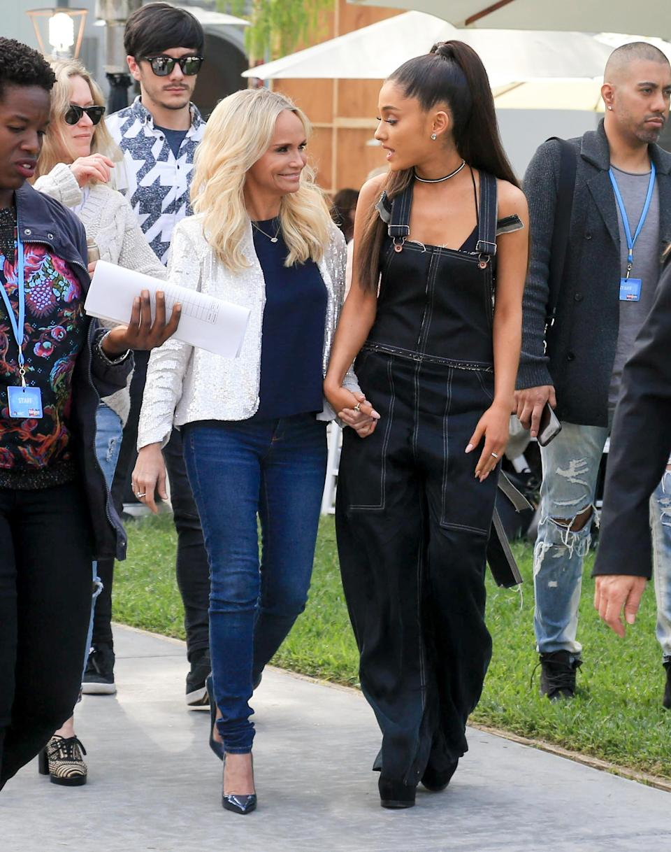 Sure, Grande can do a matching two piece set or sweater/boot combo like no other but she can also pull off a denim dungaree making it look both functional <em>and</em> sexy.