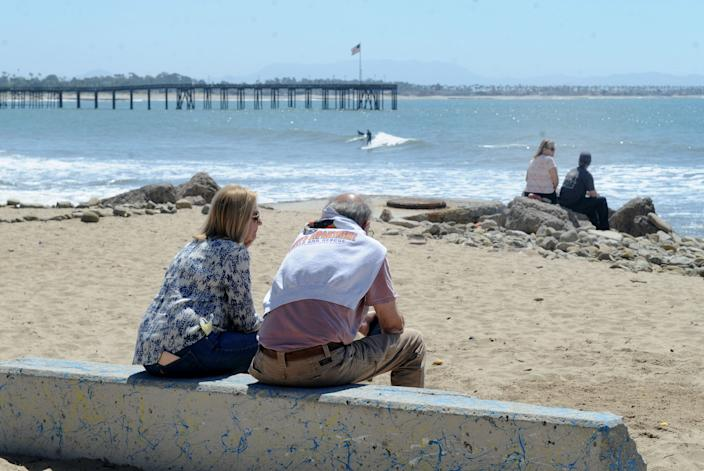 People relax near the Ventura pier on Tuesday, April 21, 2020.
