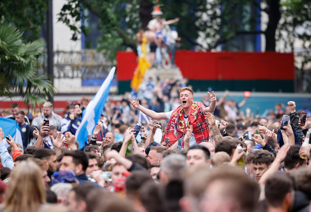 TOPSHOT - Scotland supporters gather in Leicester Square in central London ahead of the UEFA Euro 2020 European Football Championship football match between England and Scotland in London on June 18, 2021. (Photo by Tolga Akmen / AFP) (Photo by TOLGA AKMEN/AFP via Getty Images)