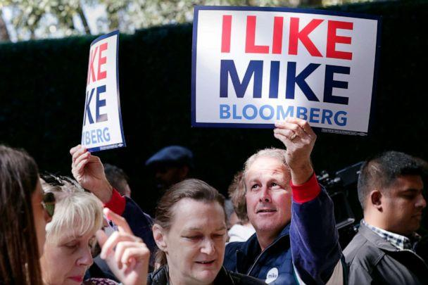 PHOTO: A supporter holds up signs as Democratic presidential candidate former New York City Mayor Mike Bloomberg speaks during a campaign event held at The Rustic Restaurant, Feb. 27, 2020, in Houston. (Michael Wyke/AP)