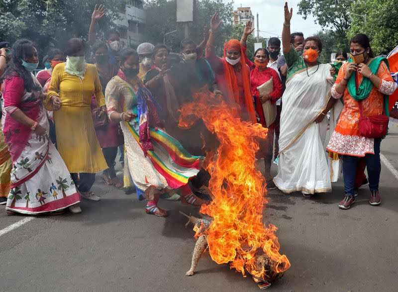 Supporters of India's ruling Bharatiya Janata Party burn an effigy during a protest against China, in Kolkata