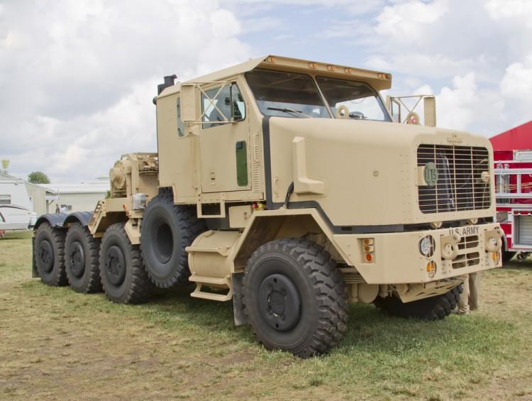 best defense stocks to buy for 2021 Oshkosh OSK Army Truck Pentagon