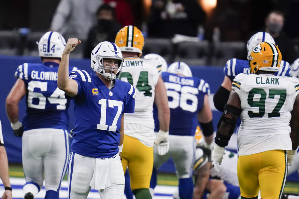 Indianapolis Colts quarterback Philip Rivers (17) celebrates throwing a touchdown pass during the second half of an NFL football game against the Green Bay Packers, Sunday, Nov. 22, 2020, in Indianapolis. (AP Photo/Michael Conroy)