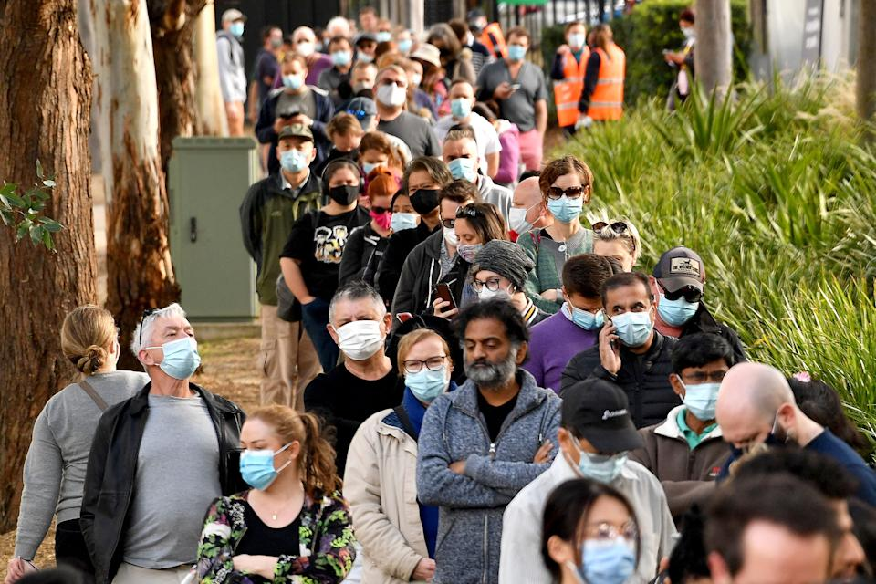 Sydneysiders queue outside a vaccination centre in Sydney on June 24. Source: Getty